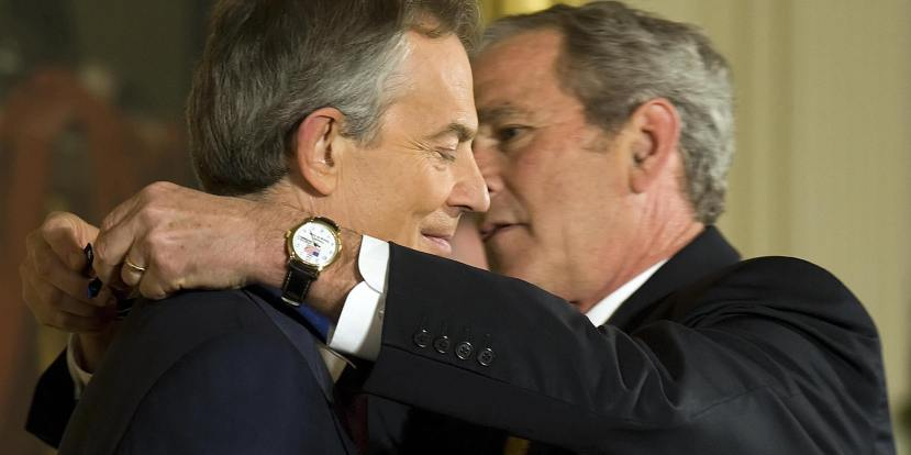 US President George W. Bush (R) awards Former British Prime Minister Tony Blair (L) Presidential Medal of Freedom in the East Room of the White House in Washington, DC, January 13, 2009. AFP PHOTO/Jim WATSON (Photo credit should read JIM WATSON/AFP/Getty Images)