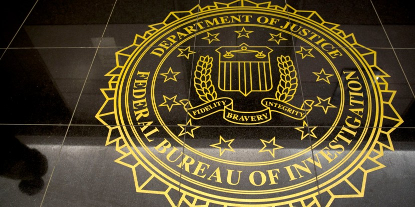 The seal of the Federal Bureau of Investigation is seen on the floor at the FBI's Washington field office in Washington, D.C., U.S., on Thursday, March 13, 2014. The FBI joined Malaysia's inquiry into the missing jet as authorities sought to retrieve deleted data on a computer flight simulator belonging to the planeÃs pilot. Photographer: Andrew Harrer/Bloomberg via Getty Images